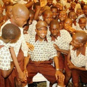 Osun-State-Governor-Rauf-Aregbesola-wears-school-uniform
